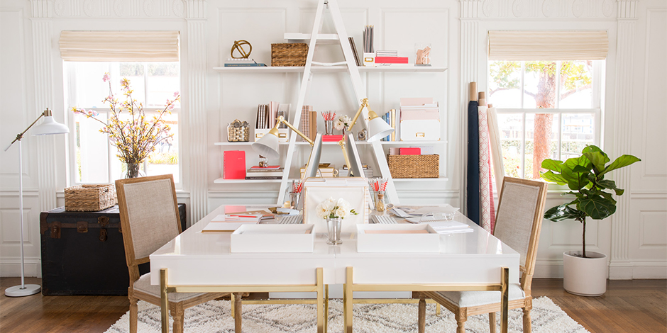 white room with sleek white and gold desk and shelves with pink gold and white sugar