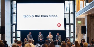 "Dinner at Target HQ with four speakers and a big white screen saying ""tech & the twin cities"""