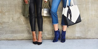 Models wearing Who What Wear's blue velvet booties and black pointy toe pumps