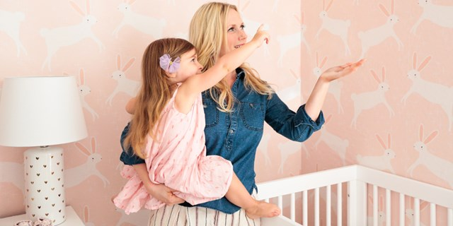 emily henderson holding baby sienna in her new pink playroom