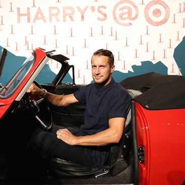 Brendan Fallis in a vintage car at the Harry's launch event