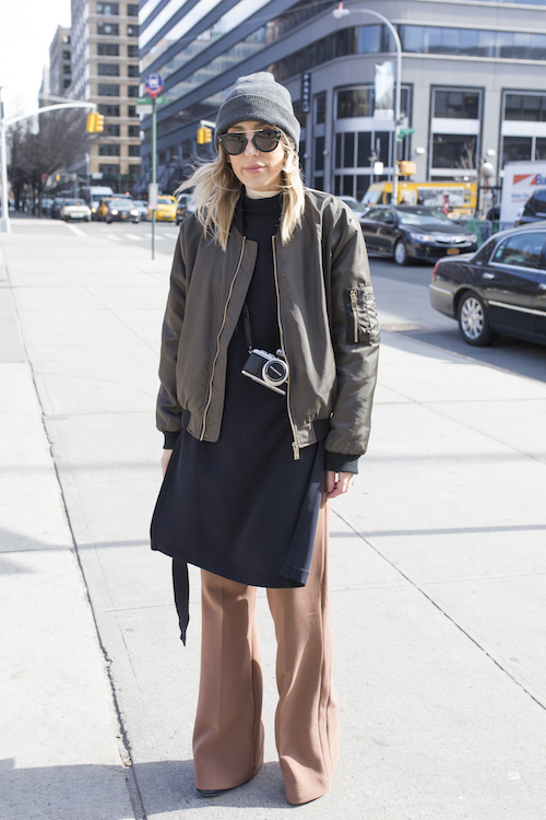 Stylist Angela Fink poses on the street during New York Fashion Week
