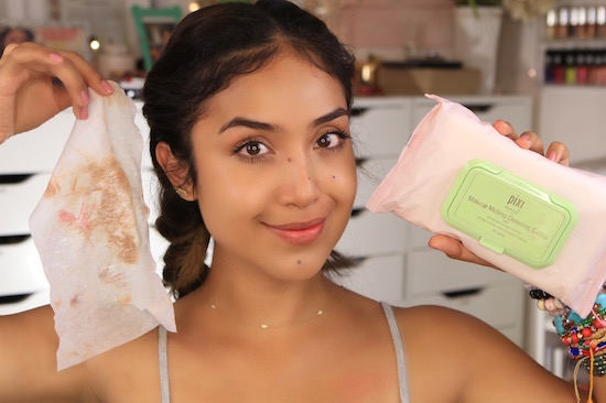 Dulce Candy removing makeup with PIXI by Petra makeup remover wipes