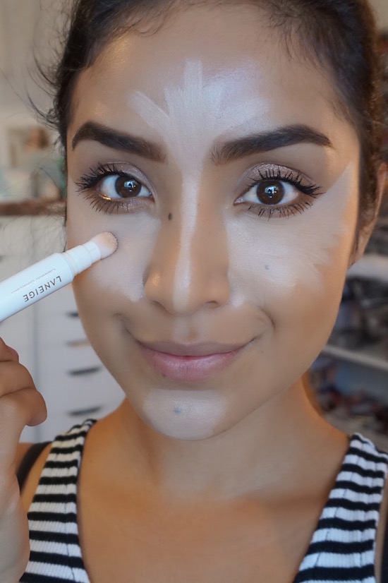 Dulce Candy applying Laneige concealer