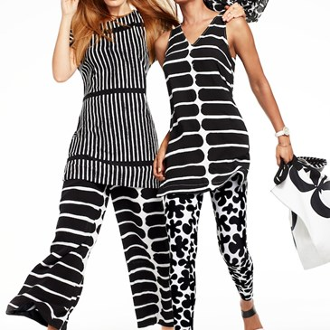 Two models dressed in black and white-printed Marimekko for Target tops, pants and accessories