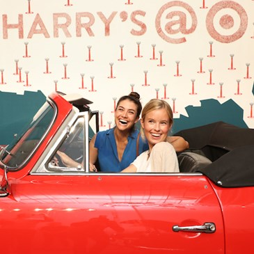 Lauren Mellor and Ally Lewis in the vintage car at the Harry's event