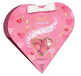A pink, heart-shaped box of Lindt Strawberries and Cream truffles