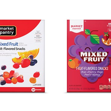 A box of the old Market Pantry fruit snacks next to the new.