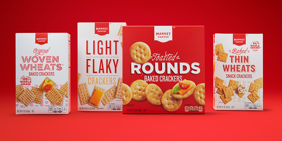 Four red and white boxes of Market Pantry crackers featuring the new packaging designs.