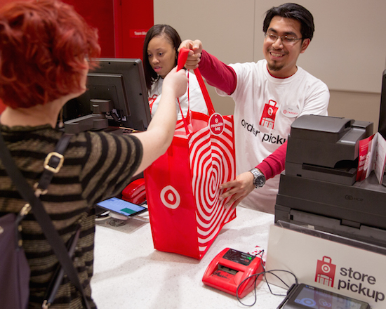 Target order pickup employee handing a guest their order