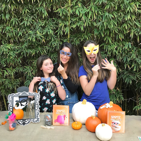 Soleil and her daughters decorating pumpkins
