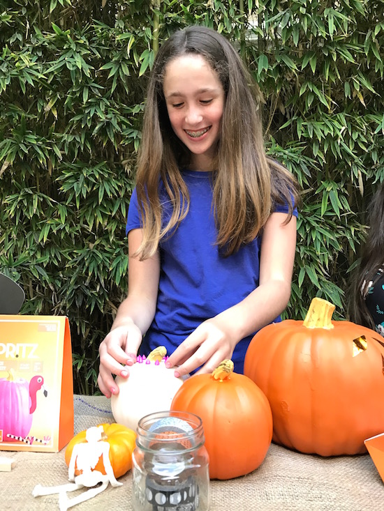 Soleil's oldest daughter decorating pumpkins