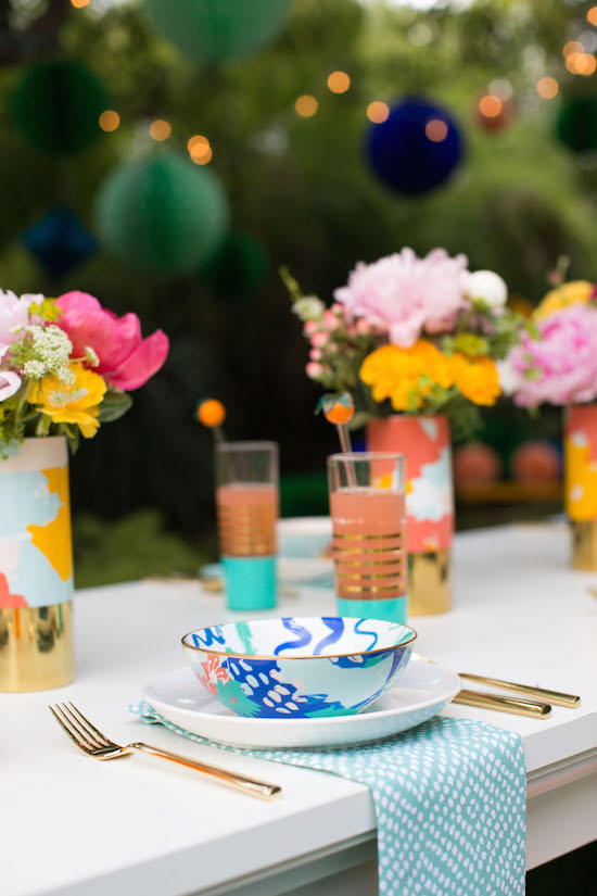 Image of outdoor dinner party with Joy's mix and match bowls, glasses, vases and more