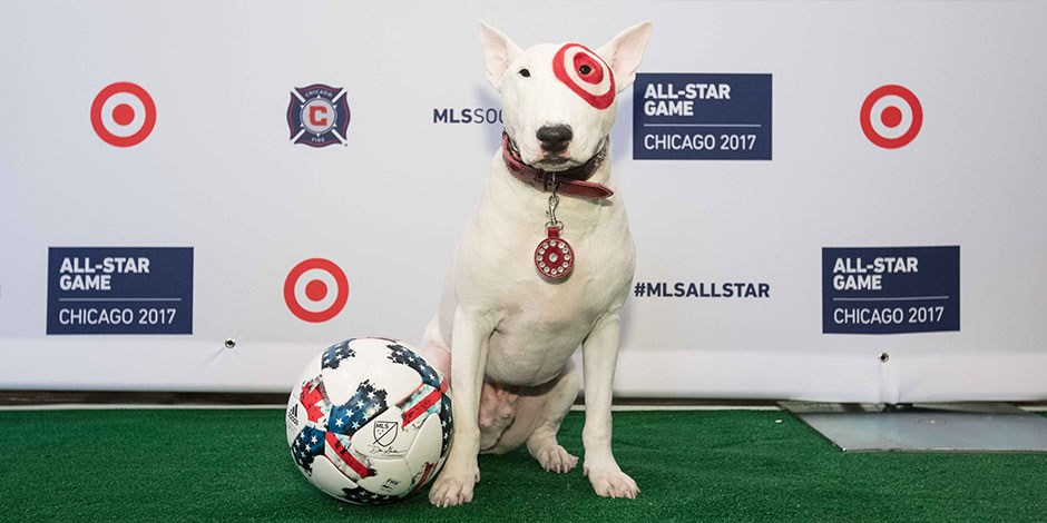 Target mascot Bullseye stands with a soccer ball at Soldier Field in Chicago