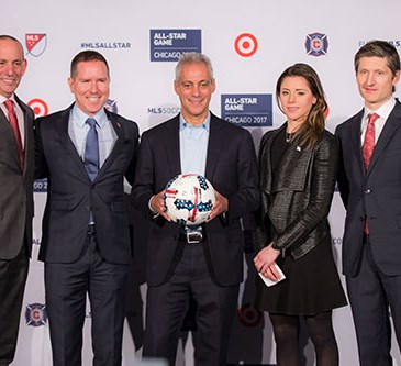 Garber, Haupton, Emanuel, Bachman and White stand holding a soccer ball at the press conference