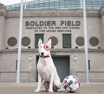Bullseye stands next to a soccer ball in front of Soldier Field