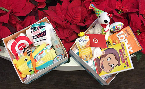 Two Boxes Of Baby Gifts And A Plush Bullseye Dog From Target