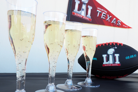 Glasses of champagne with football gear in the background