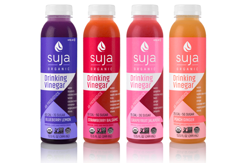 Four flavors of Suja's Organic Drinking Vinegars shown against a white background