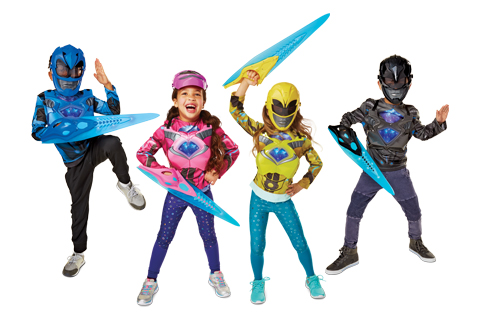 Four kids dressed as the Blue, Pink, Yellow and Black Power Rangers