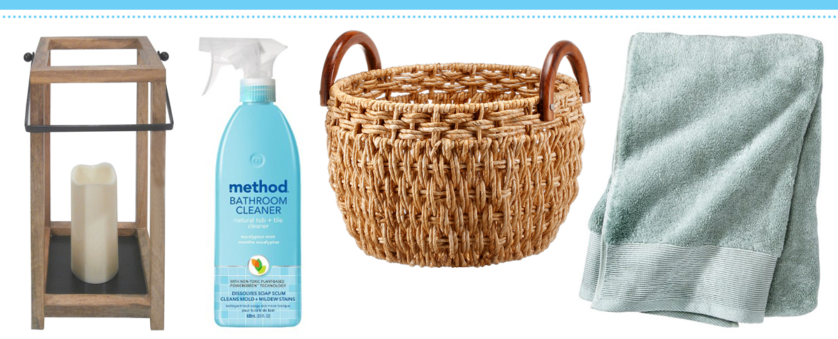 A wooden lantern, bathroom cleaner, woven basket and blue towel
