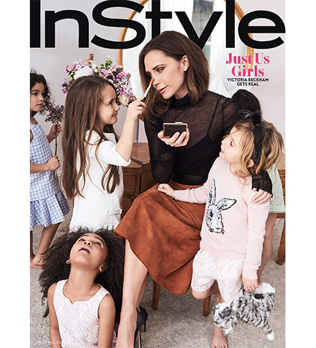 the cover of InStyle magazine featuring Victoria Beckham surrounded by little girl models wearing designs from the collection