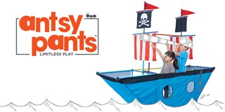 Two children play with the Antsy Pants pirate ship kit.