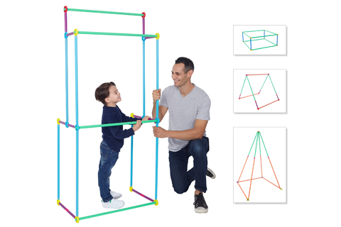 A little boy builds a play kit frame with help from dad.