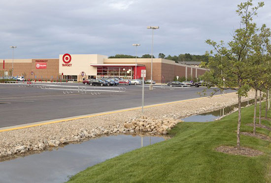 A Target store with rain garden in its parking lot