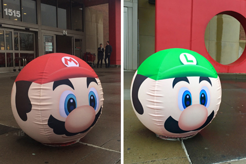 Bollards outside a Target store decorated as Mario and Luigi