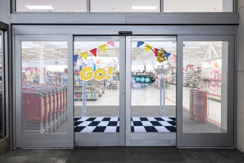 Target's doors open to reveal a starting line, Go sign, colored flags, lights and more
