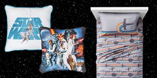 Two throw-back pillows, featuring Star Wars characters, and a Millennium Falcon bedding set