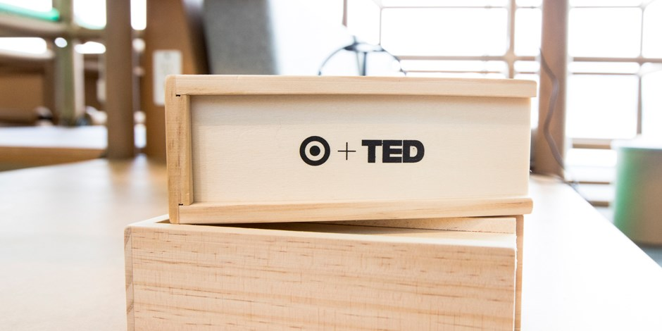 a Target + TED image appears in black on a piece of natural-hued wood.