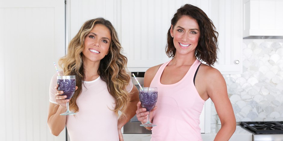 Karena Dawn and Katrina Scott pose with purple smoothies made with their Target-exclusive protein