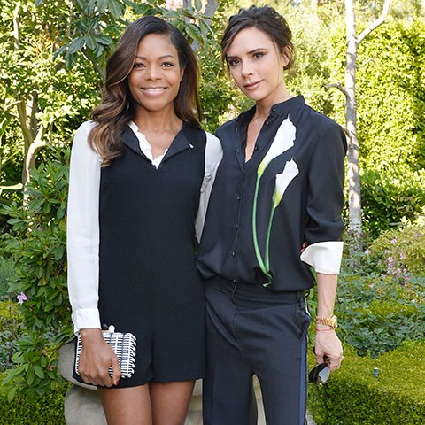 Victoria Beckham and Naomie Harris pose together outiside in the garden