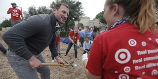 Jason Witten pitches in to build a new playground with Target volunteers