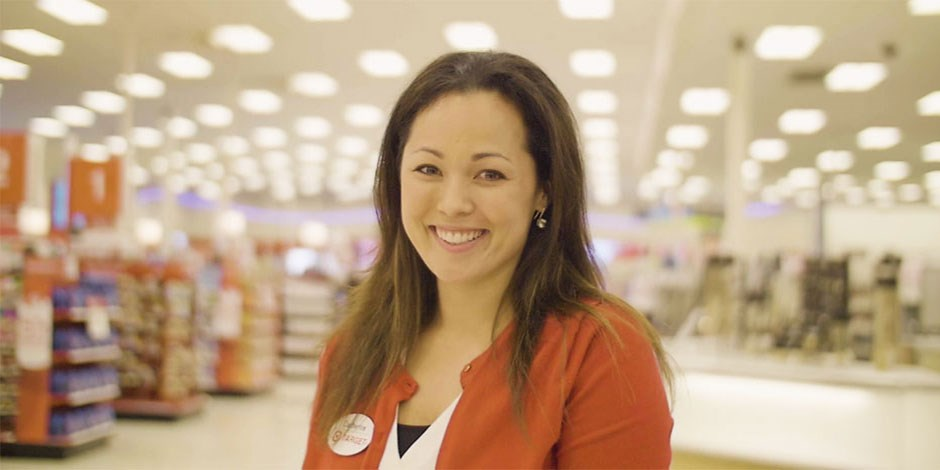 DTL Catherine Helm standing in front of the checklanes in a Target store