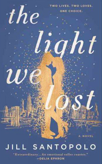 "The cover of ""The Light We Lost,"" showing a silhouette of a couple against a city background"