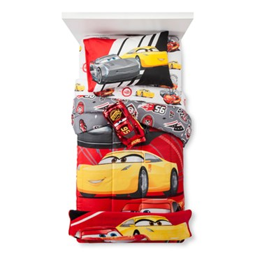 A twin-sized bed tricked out in Cars 3 bedding featuring the characters against red background
