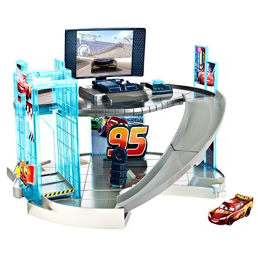 A two-level racing center with lift and ramp adorned with #95