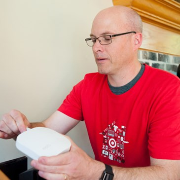 A volunteer installs the Eero device.