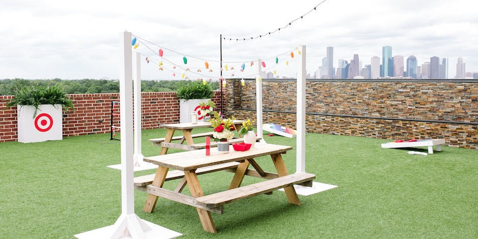 Outdoor picnic set up with tables and string lights
