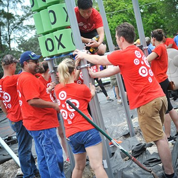 Volunteers build the jungle gym and tic-tac-toe board