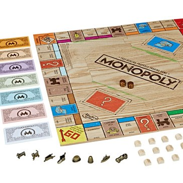 Wooden Monopoly board with game peices