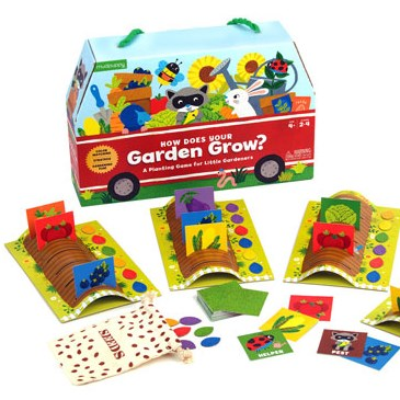 Box printed with a red wagon full of produce, flowers and animals, with garden row game pieces