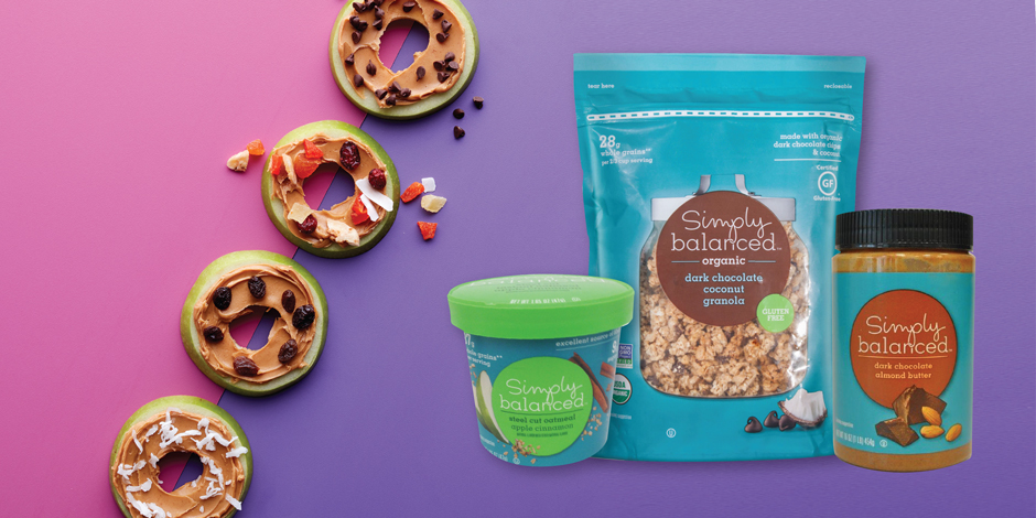 Apple rings covered in nut butter and toppings are shown with Simply Balanced granola & oatmeal cups