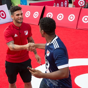 MLS player Dom Dwyer shakes hands with a fan.