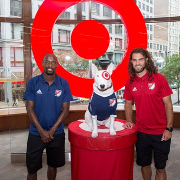 Demarcus Beasley and Graham Zusi pose with Bullseye.