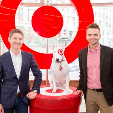 William White and Justin Burns pose with Bullseye.