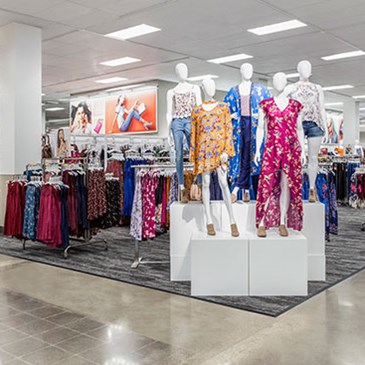 The apparel floorpad with mannequins in brightly colored outfits